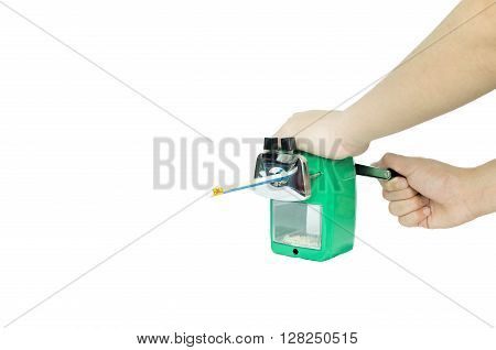 Asian boy sharpening his pencil with green sharpener on white background
