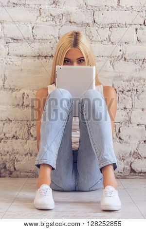 Attractive Young Woman With Gadget