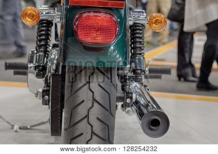 Close up of  rear view of motorcycle indoor photo.