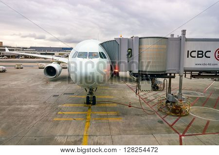 FRANKFURT, GERMANY - APRIL 07, 2016: aircraft docked in Frankfurt Airport. Frankfurt Airport is a major international airport located in Frankfurt