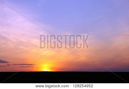 Sunset sky background. Beautiful sky. Landscape. Sunny sunset in a field.