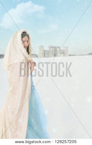 portrait of winter princess in the snow