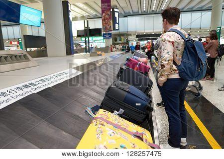 HONG KONG - APRIL 09, 2016: baggage claim area in Hong Kong International Airport. Hong Kong International Airport is the main airport in Hong Kong