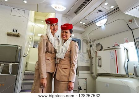HONG KONG - APRIL 09, 2016: Emirates crew members on board of Airbus A380. Emirates is an airline based in Dubai, United Arab Emirates. It is the largest airline in the Middle East.