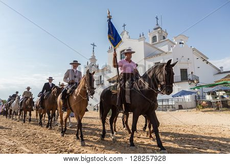 El ROCIO, ANDALUCIA, SPAIN - MAY 22: Romeria after visiting the Sanctuary goes to village.  2015  It is one of the most famous pilgrimage of Spain. This pilgrimage passes from the 15th century.