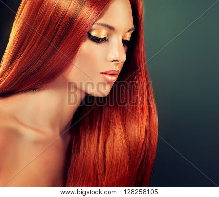 Beautiful girl model with long straight  shiny  red hair . Healthy well-groomed hair . Red head woman elegant hairstyle