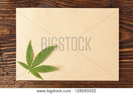 Handmade hemp paper on wooden table top view. Natural organic handmade paper.
