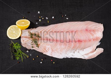 Luxurious perch fillet on black background top view. Culinary fish eating.