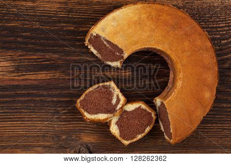 Delicious bundt cake on wooden table top view. Traditional european sweet bundt cake.