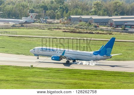 VNUKOVO MOSCOW REGION RUSSIA - 12 August 2015: Airplanes at Vnukovo international airport. Pobeda Airlines Boeing 737 landed on runway