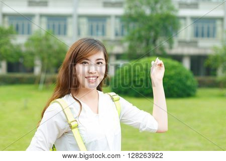 young beautiful asian girl in school