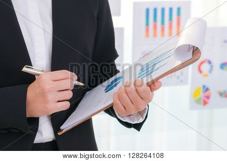 Business people using  and Financial charts  at meeting office