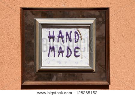 frame with hand made sign on building facade