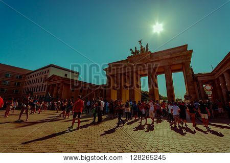 BERLIN, GERMANY - JUNE 06, 2015: Turists visiting Brandenburger gate in a nice sunny day, people walking around