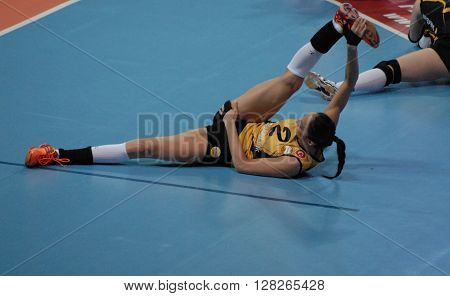 ANKARA/TURKEY-April 30, 2016: Vakifbank's player Gozde Kirdar doing some muscular stretching exercises during the warming up of Volleyball Women 1st Laegue of Turkey matches at the Baskent Volleyball Hall. April 30, 2016-Ankara/Turkey