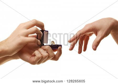 One groom giving wedding ring to another man isolated on white
