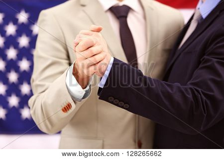 Two homosexuals dancing on American flag background
