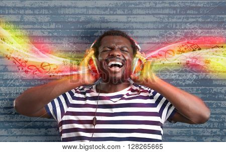 African American listening to music in headphones with streaming melody from it