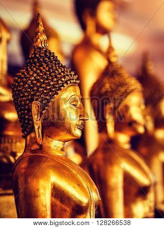 Vintage retro effect filtered hipster style image of golden Buddha statues in buddhist temple Wat Saket (The Golden Mount), Bangkok, Thailand
