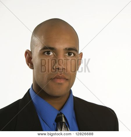 Head and shoulder portrait of African American man in suit.
