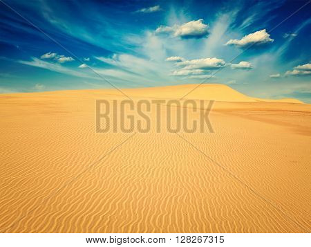 Vintage retro effect filtered hipster style image of white sand dunes in desert on sunrise, Mui Ne, Vietnam.