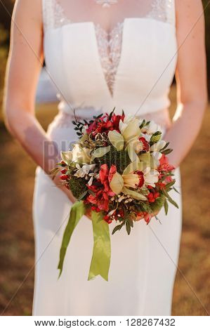 beautiful colorful fresh flowers wedding bouquet in bride's hands
