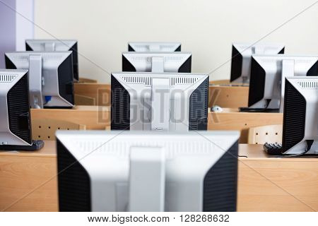 Computers Arranged On Desks In Classroom