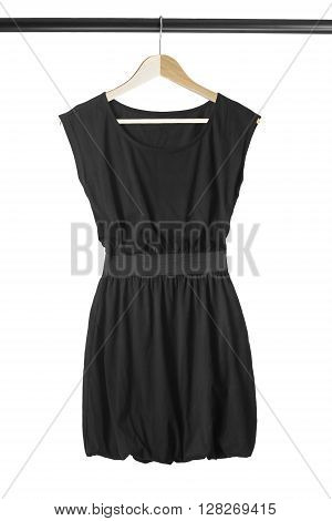 Black basic dress on wooden clothes rack on white background
