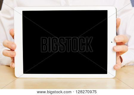 Female hands holding empty tablet PC with black touchscreen