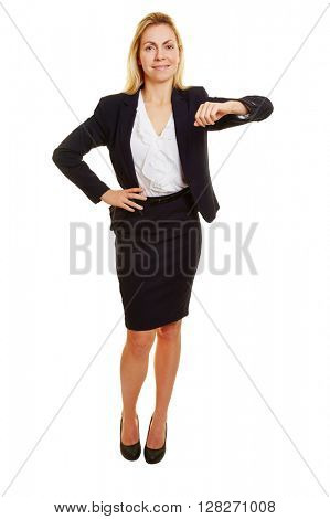Young blonde business woman leaning on imaginary corner with her arm