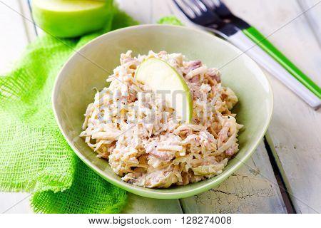 fish apples and mayonnaise salad. selective focus