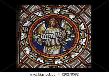 OBERSTAUFEN, GERMANY - OCTOBER 20: Symbols of the Saint Matthew the Evangelist, stained glass window in the parish church of St. Peter and Paul in Oberstaufen, Germany on October 20, 2014.