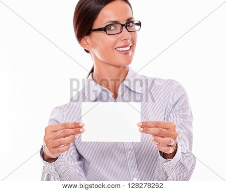 Happy brunette businesswoman with glasses wearing her long hair tied back and a button down shirt looking excited holding a blank copy space with both hands in front of her