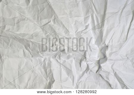 Close up of a creased, white paper texture, full frame, horizontal
