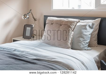 Modern Bedroom With Single Bed And Modern Lamp