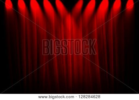 spotlight with red curtain background