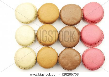 assorted freshly baked macarons on a white background