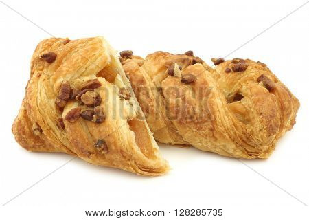 freshly baked pecan buns with apricot filling on a white background