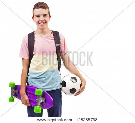 Portrait of a school boy holding a skateboard and a soccer ball, isolated on white
