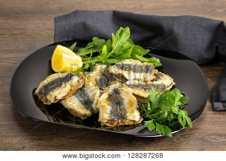 Turkish grilled sardine fillets with parsley and lemon.