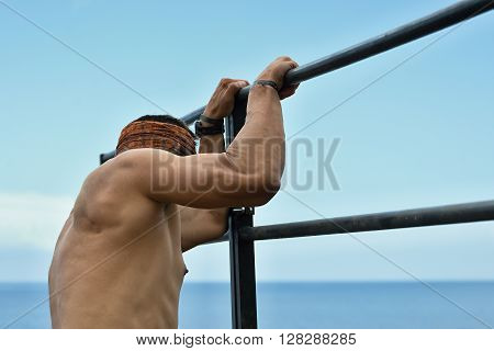 Participants in extreme obstacle race climbing over hurdle ** Note: Soft Focus at 100%, best at smaller sizes