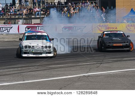 Lviv Ukraine - Juny 7 2015: Unknown riders on the car brand Nissan and BMW overcomes the track in the championship of Ukraine drifting in Lviv.