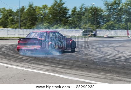 Lviv Ukraine - Juny 6 2015: Unknown rider on the car brand Ford overcomes the track in the championship of Ukraine drifting in Lviv.