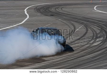 Lviv Ukraine - Juny 7 2015: Unknown rider on the car brand Nissan overcomes the track in the championship of Ukraine drifting in Lviv.