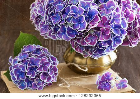 Beautiful bouquet of flowers.Still Life with Hortensia Flowers on a brown background .