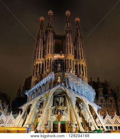 Barcelona, Spain - September 22nd, 2015: Cathedral of La Sagrada Familia at night. It is designed by architect Antonio Gaudi and is being build since 1882.
