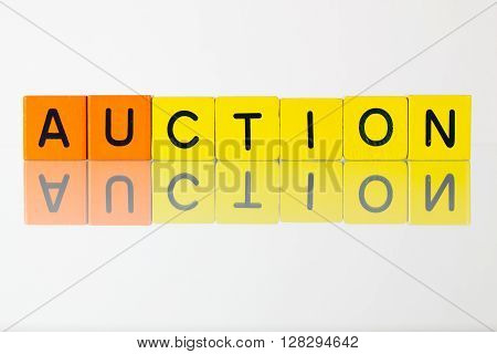 Auction - an inscription from children's wooden blocks
