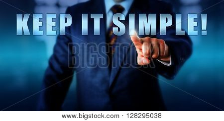 Business coach is pressing KEEP IT SIMPLE! on a virtual touch screen interface. Call to action motivational appeal and business concept for a straight-forward tactical approach to management.