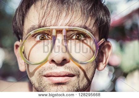 The face of young men wearing a strange glasses
