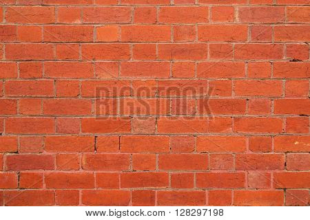 Closeup background texture photo of red brick wall